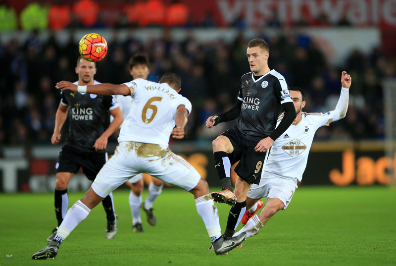 Leicester City's Jamie Vardy, centre right, gets the ball away while under pressure from Swansea City's Leon Britton, right, and Ashley Williams during their English Premier League soccer match at the Liberty Stadium, Swansea, Wales on Saturday, December 5, 2015. Photo: AP