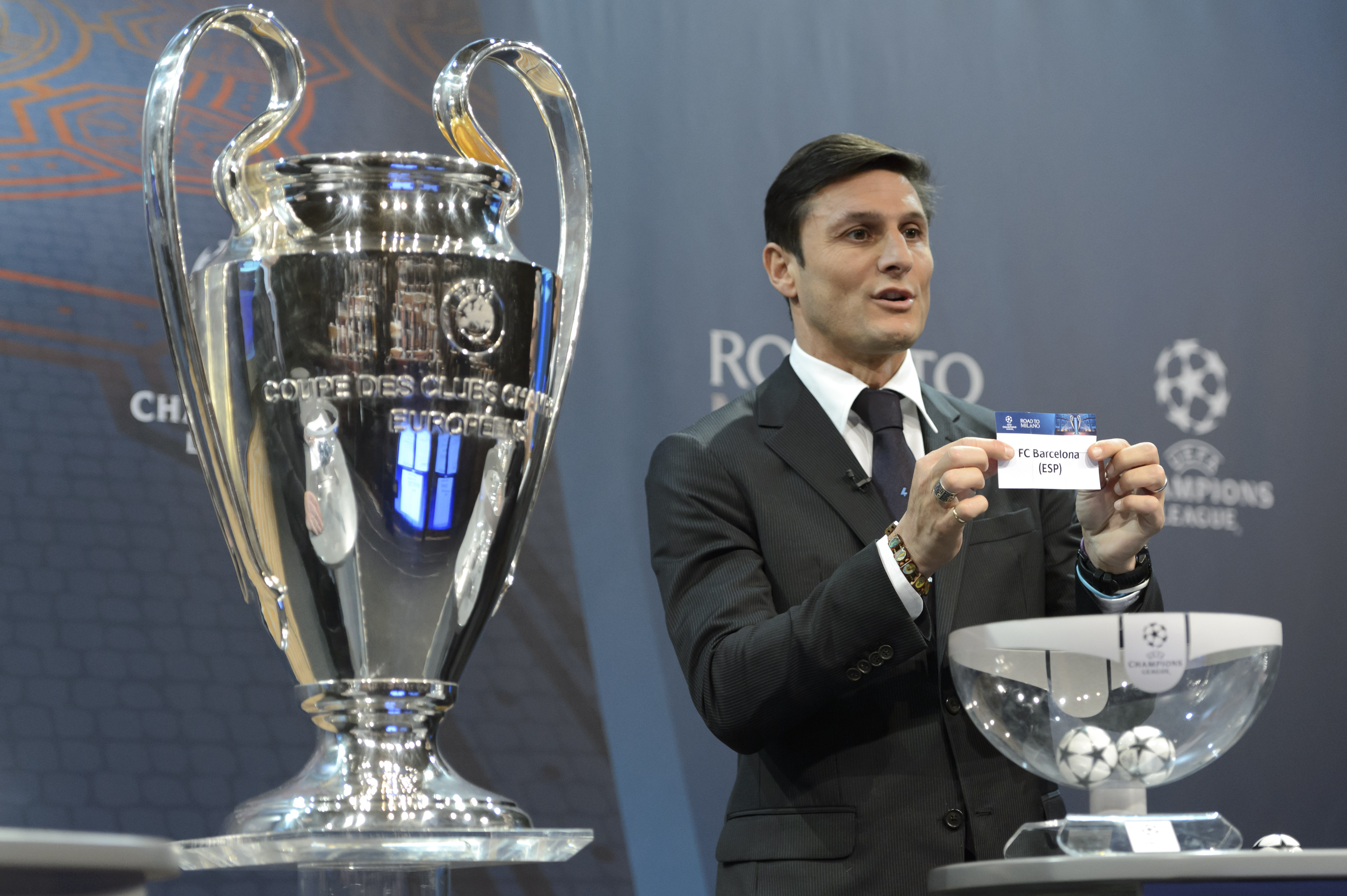 Former Italian soccer player Javier Zanetti, ambassador for the UEFA Champions League final in Milan,  shows the  ticket of FC Barcelona during the draw of the 2015/16  Champions League Round of 16 at the UEFA Headquarters in Nyon, Switzerland, Monday, Dec. 14, 2015. Photo: AP