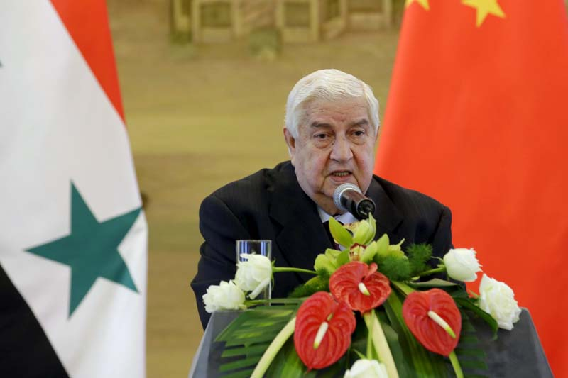 Syria's Foreign Minister Walid al-Moualem speaks during a joint news conference with China's Foreign Minister Wang Yi (not seen) after a meeting at the Ministry of Foreign Affairs in Beijing, China, on December 24, 2015. Photo: Reuters