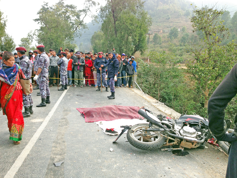 Relatives of two motorcycle riders obstract the road along the Prithvi Highway demanding compensation after the riders died after being hit by a tipper in Ghansikuwa of Tanahun district on Thursday, December 31, 2015. Photo: Madan Wagle