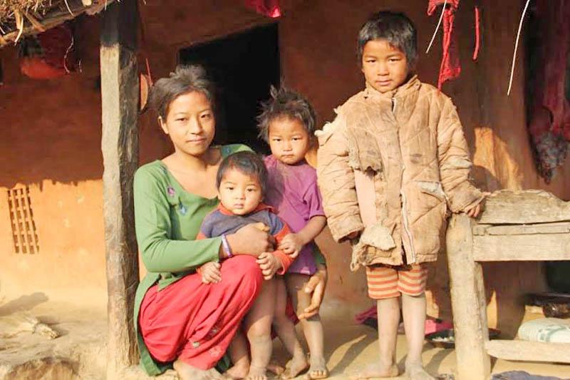 A teenage mother of Chepang community with her three children in Jogimar of Dhading district. Photo: Keshav Adhikari