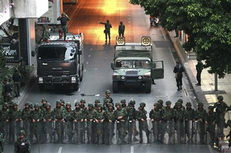 FILE - In this May 26, 2014 file photo, Thai soldiers secure a road near the Victory Monument in Bangkok, Thailand. Photo: AP