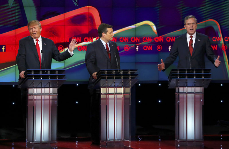Republican US presidential candidate businessman Donald Trump (Left) responds to criticism from former Governor Jeb Bush (Right) as Senator Ted Cruz (Centre) looks on during the Republican presidential debate in Las Vegas, Nevada December 15, 2015.    Photo: Reuters