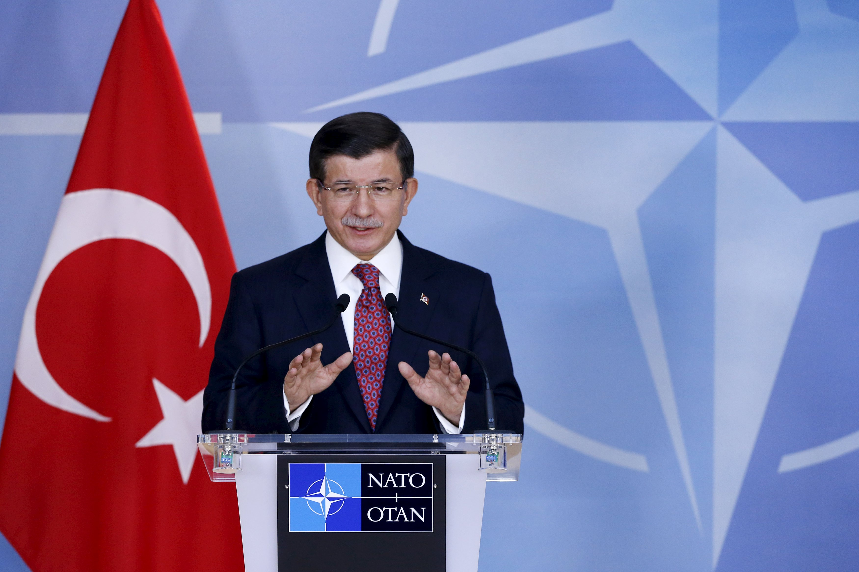 Turkish Prime Minister Ahmet Davutoglu addresses a news conference after meeting NATO Secretary-General Jens Stoltenberg at the Alliance's headquarters in Brussels, Belgium, November 30, 2015. Photo: Reuters