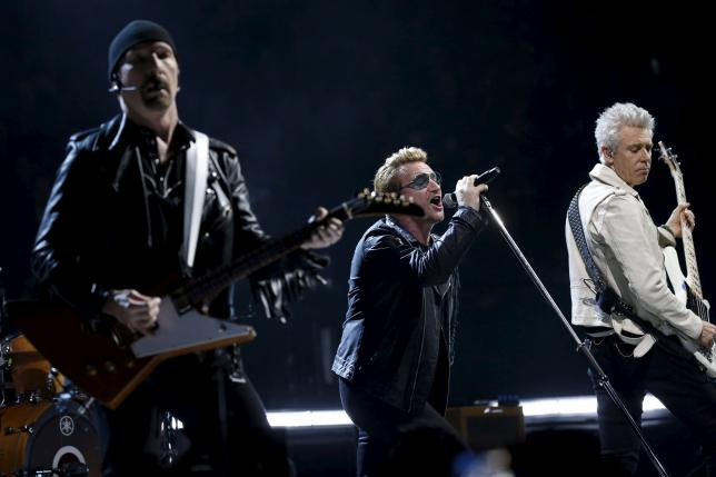 Bono (C), the Edge (L) and Adam Clayton of Irish band U2 perform during their concert at the AccorHotels Arena in Paris, France, December 6, 2015, on their iNNOCENCE + eXPERIENCE Tour. REUTERS/Benoit Tessier