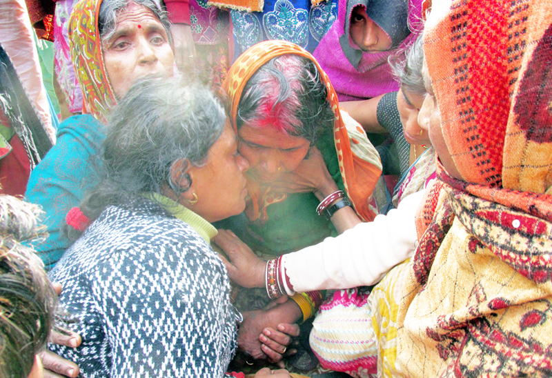 Bereaved family members of CPN-UML leader Ram Naresh Raya Yadav, in Sarlahi, on Tuesday, December 29, 2015. Photo: THT