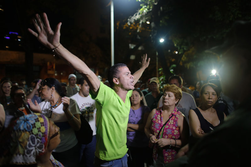 Opposition supporters celebrates the closing of a polling station during congressional elections in Caracas, Venezuela on Sunday, December 6, 2015. Photo: AP