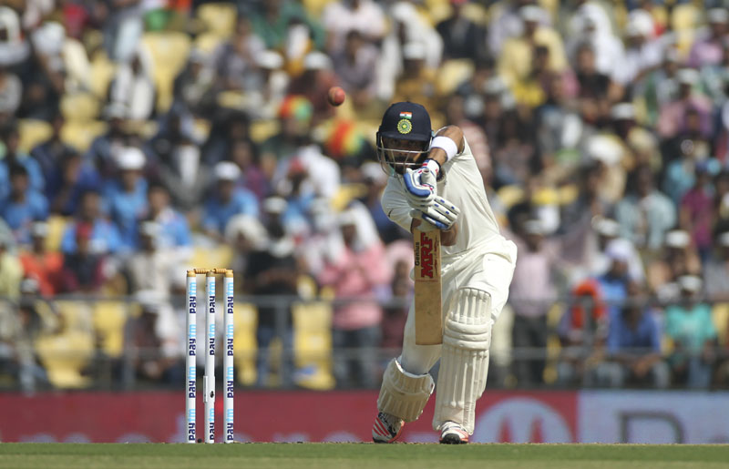 Indian batsman Virat Kohli plays a shot while playing against South Africa on the first day of the third test match between the two countries in Mumbai, India on Wednesday, November 25, 2015. Photo: AP