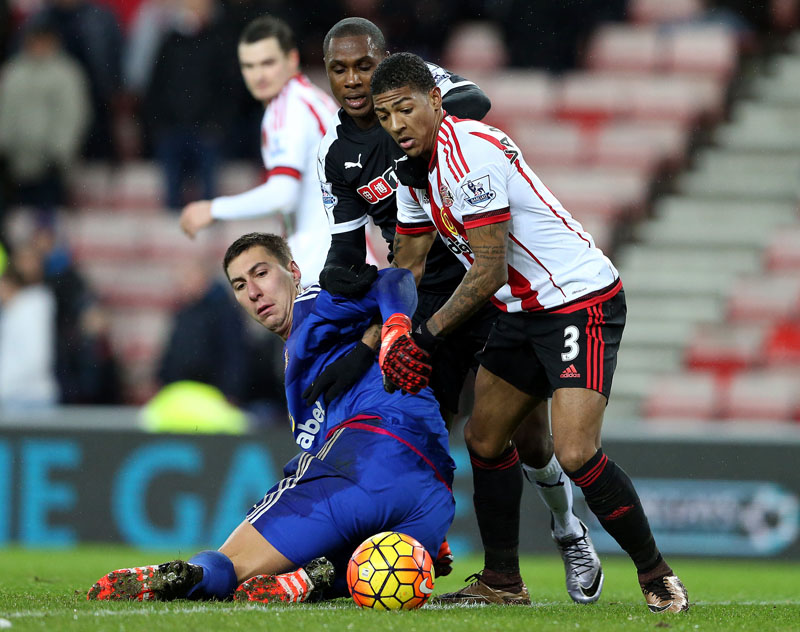 Watford's Odion Ighalo (centre) vies for the ball with Sunderland's goalkeeper Costelm Pantilimon (left) and Patrick Van Aanholt (right) during the English Premier League soccer match between Sunderland and Watford at the Stadium of Light, Sunderland, England on Saturday, December 12, 2015. Photo: AP