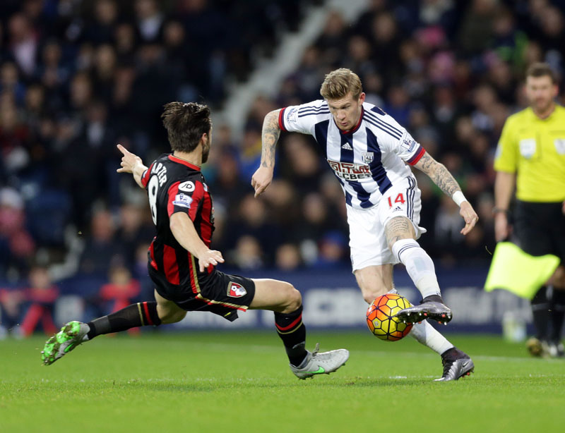 West Bromwich Albion's James McClean (right) is tackled by AFC Bournemouth's Harry Arter during the English Premier League soccer match at The Hawthorns, West Bromwich, England on Saturday December 19, 2015. Photo: AP