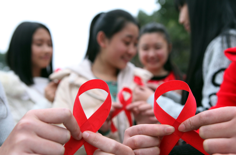 This picture taken on November 30, 2015 shows volunteers taking part in an event to mark World Aids Day in Chongqing. Photo: AFP