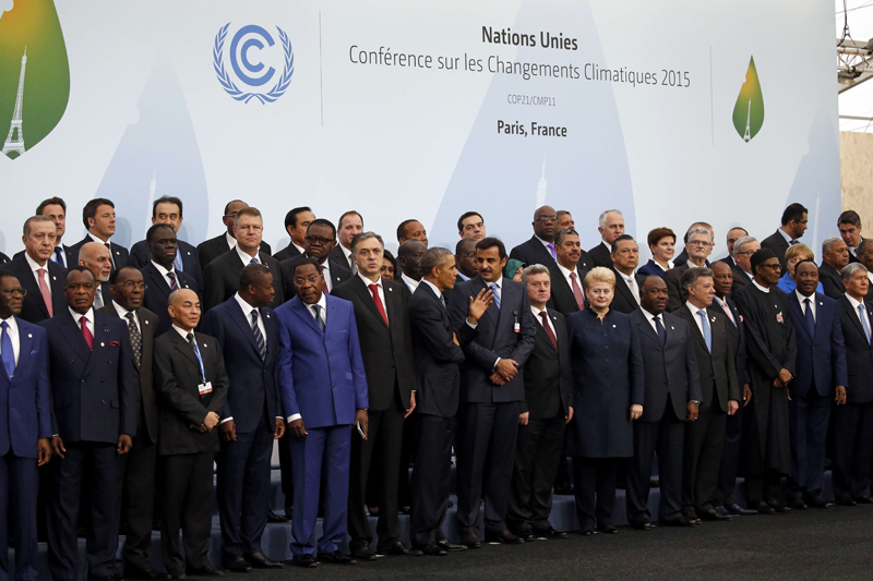 US President Barack Obama (centre) talks with fellow world leaders during a family photo for the opening day of the World Climate Change Conference 2015 (COP21) at Le Bourget, near Paris, France, on November 30, 2015. Photo: Reuters