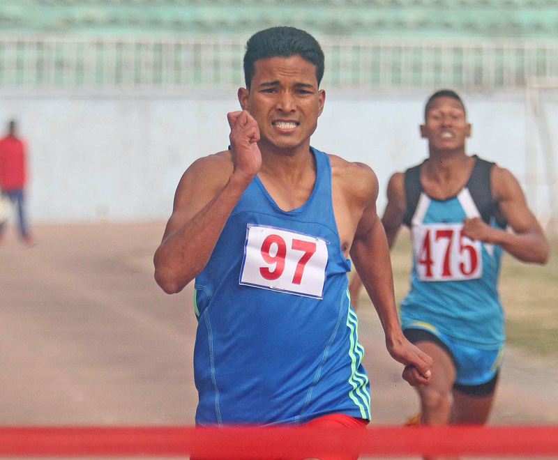 Yam Sajan Sunar of Nepal APF Club runs on his way to winning the 200m race during an open selection tournament at the Dasharath Stadium on Saturday. Photo: Udipt Singh Chhetry/THT