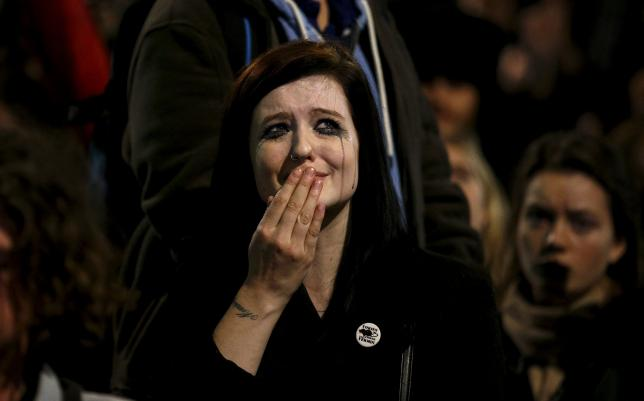An anti-war protestor cries after the British parliament voted in favour of air strikes against militants in Syria, during a demonstration outside the Houses of Parliament in London, Britain, December 2, 2015. REUTERS/Peter Nicholls