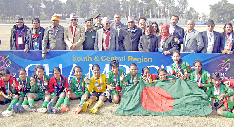 Bangladesh team members and officials pose with Prime Minister KP Sharma Oli after winning the AFC U-14 Girlsu2019 nRegional Championship in Lalitpur on Sunday.