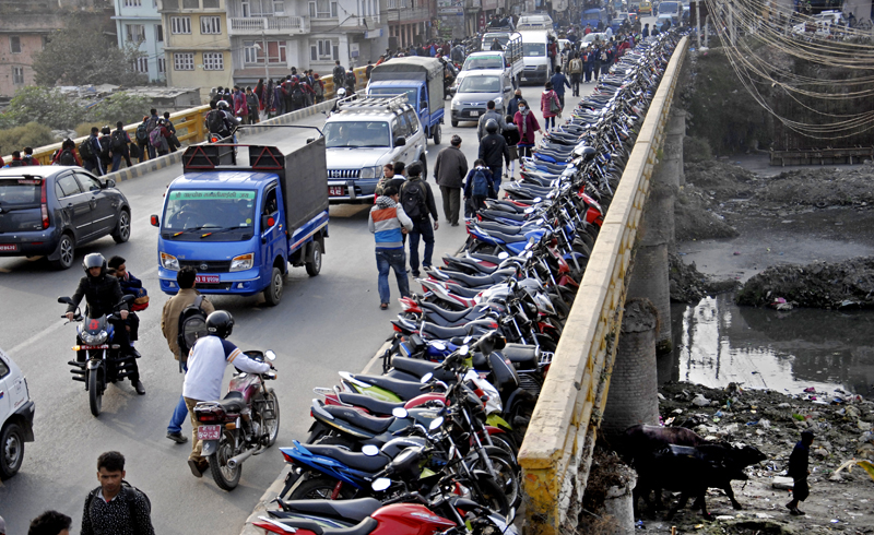 Scores of motorbikes were parked on nKalimati bridge near a petrol pump, in Kathmandu, on Sunday, after the ngovernment announced that petrol would  be sold to privately-owned two-wheelers on four alternate days from Tuesday to Monday.