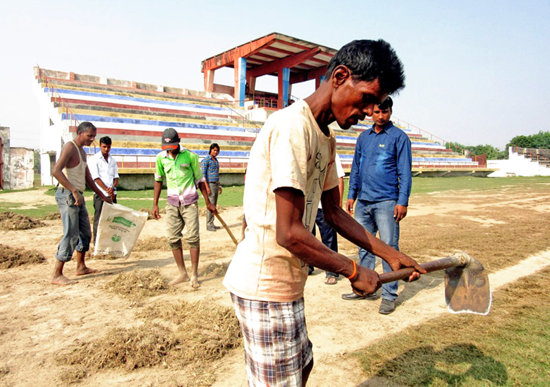 Labourers renovates the track anf field at the Narayani Stadium in Birgunj on Tuesday, December 01, 2015. Photo: Ram Sarraf