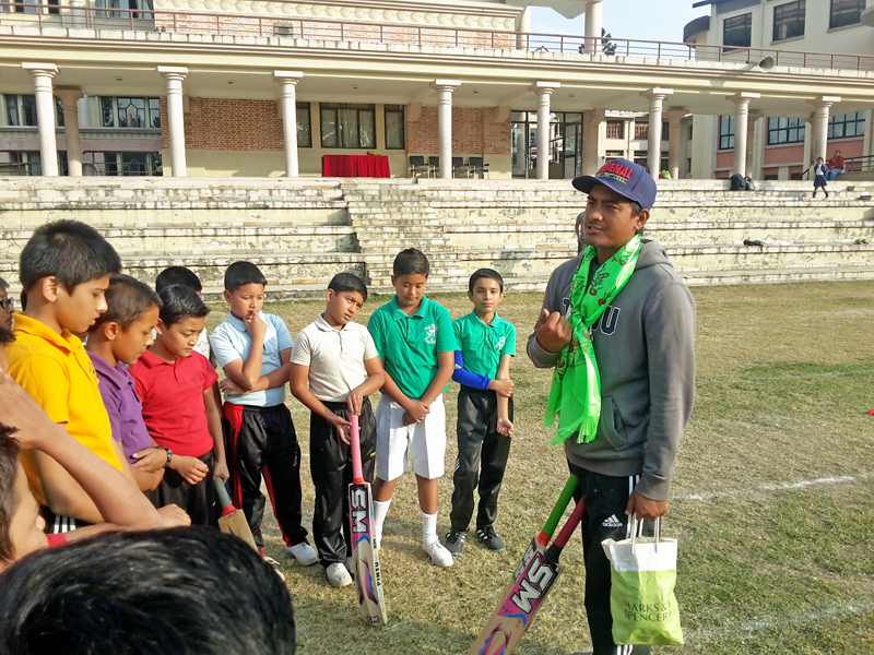 National cricket team vice-captain Gyanendra Malla interacts with school kids during School Cricket Workshop organised by Ruslan Cricket in Kathmandu on Monday, December 21, 2015. Photo: THT
