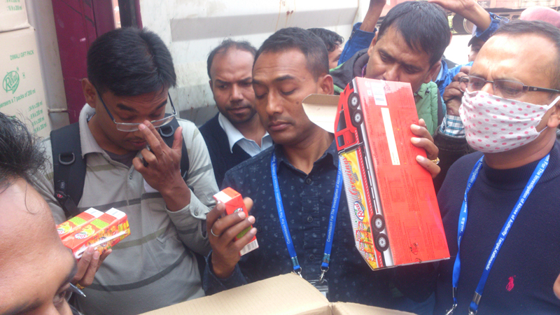 A Commission for the Investigation of Abuse of Authority team seizing products of Dabur Nepal, in Birgunj, on Sunday, December 13, 2015. Photo: Ram Sarraf