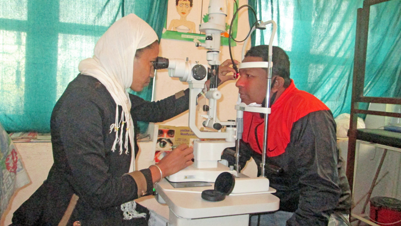 Health professional examine eyes in a free Eye Camp organised by Damauli based hosptial in Tanahun district. Photo: THT