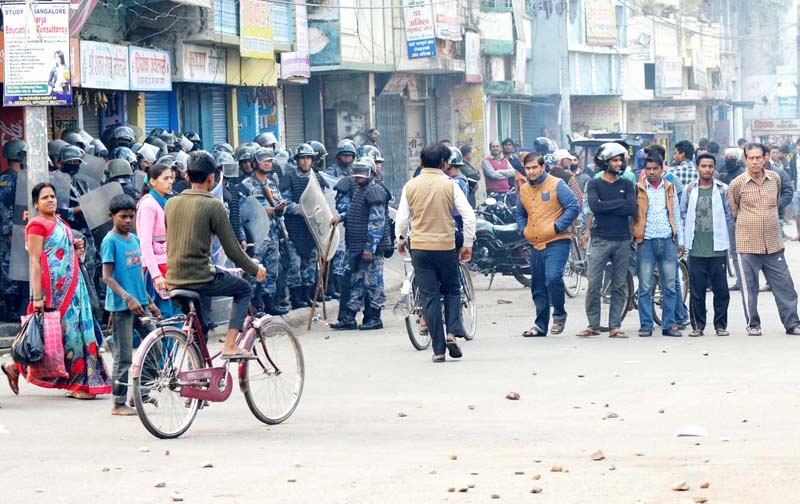 Scores of police personnel guarding a road section in Birgunj after the United Democratic Madhesi Front (UDMF) intensified protest, on Sunday, December 20, 2015. Photo: Ram Sarraf/ THT