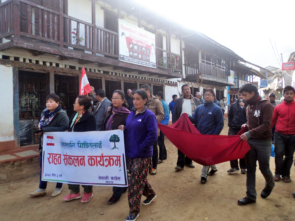 Cadres affilated with Nepali Congress colletiing relief materials for the Diktel fire victims in Khotang on Friday, December 18, 2015. Photo: Dilip Khatri