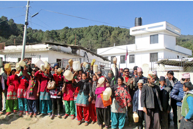 Local people carrying empty-jerrycans demand water infront of Dolakha District Administration Office on Tuesday, December 29, 2015. Photo: RSS
