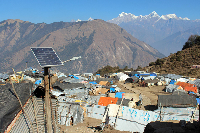 Tents and huts made by April 25 earthquake survivors for temporary residence in Laprak of Gorkha, as pictured on Saturday, December 26, 2015. The survivors there still await reconstruction of their collapsed houses. Photo: RSS
