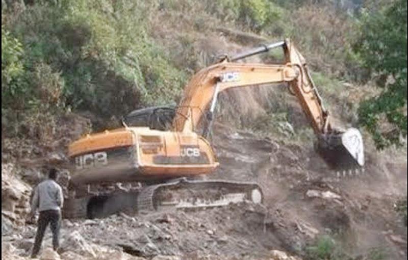An excavator constructing a road in Tabal of Ri VDC in Dhading district, on Sunday, December 06, 2015. Photo: Keshav Adhikari