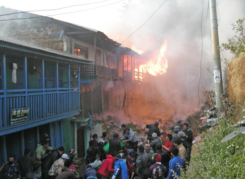 Locals and security personnel fighting the fire that broke out early in the morning, in Diktel, Khotang, on Thursday.  Photo: THT