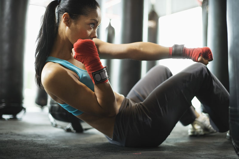 Woman doing crunches in gym
