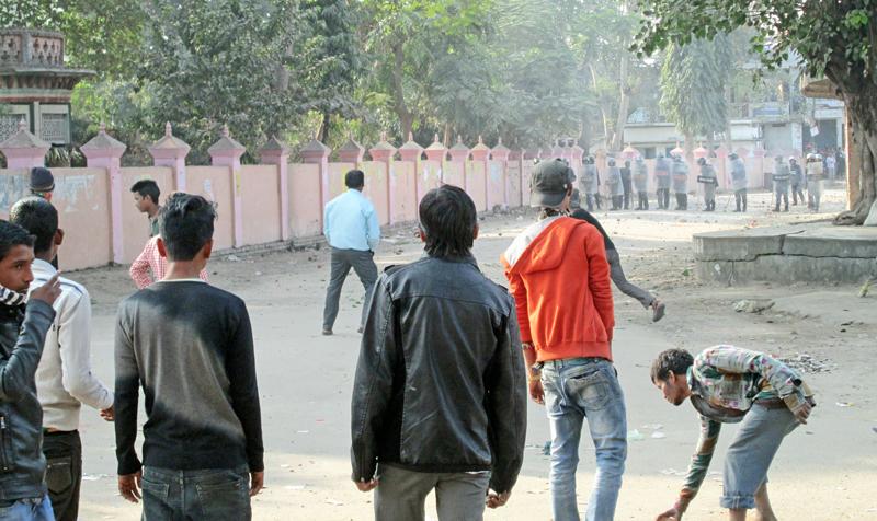 Demonstrators pelting stones at security personnel in Janaki Chok, Janakpur, on Monday, December 28, 2015. Photo: THT