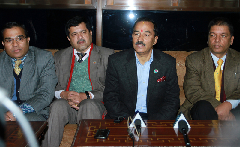 Deputy Prime Minister Kamal Thapa and Law Minister Agni Prasad Kharel (2nd and 3rd from right respectively) talk to mediapersons before they leave for China, on Wednesday, December 23, 2015. Photo: RSS