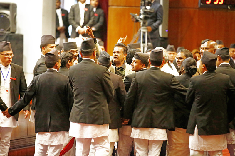 Marshals of the Legislature-Parliament cordoning off senior leaders of the United Democratic Madhesi Front as they chant slogans objecting to the tabling of bills on constitution amendment and reconstruction authority, while they were being tabled in the Parliament, in Kathmandu, on Tuesday, December 15, 2015. Photo: Skanda Gautam / THT