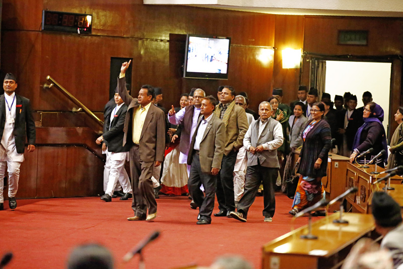 Lawmakers of the protesting United Democratic Madhesi Parties (UDMF) obstruct the Parliament meeting demanding that the House proceedings should not move ahead until their demands meet in New Baneshwor, Kathmandu, Nepal on Sunday, Dec. 6, 2015. The UDMF has been staging demonstrations in various parts of the Tarai-Madhes region, protesting the demarcation of federal units in the Constitution. The lawmakers have been obstructing the House for last few weeks. Photo: Skanda Gautam