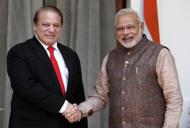 Prime Minister Narendra Modi (R) shakes hands with his Pakistani counterpart Nawaz Sharif before the start of their bilateral meeting in New Delhi May 27, 2014. REUTERS/Adnan Abidi/Files