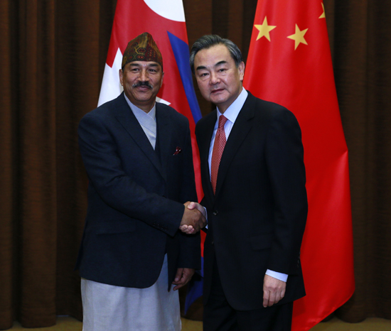 Nepal's Deputy Prime Minister and Minister for Foreign Minister Kamal Thapa and his Chinese counterpart Wang Yi shake hands after holding bilateral meeting between Nepal and China in Beijing, China on Friday, December 25. Photo: China's Ministry of Foreign Affairs