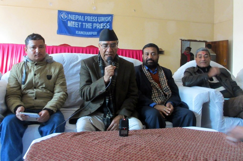 Nepali Congress senior leader Sher Bahadur Deuba (2nd from left) speaks with journalists in Kanchanpur on Saturday, December 26, 2015. Photo: RSS