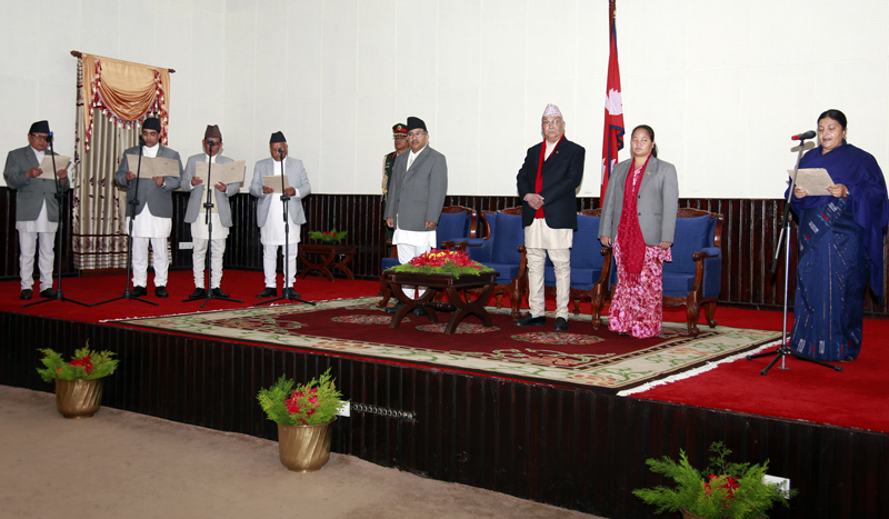 President Bidya Devi Bhandari administers the oath of office and secrecy to newly appointed ministers at the Sheetal Niwas in Kathmandu, on Thursday, December 24, 2015. Photo: RSS