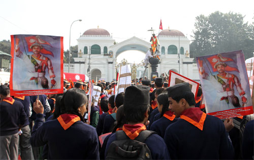Students gather in front of the statue of Prithvi Narayan Shahu201a the creator of modern Nepalu201a to mark his birth anniversaryu201a in Kathmandu on Sundayu201a January 11u201a 2014. Photo: RSSn