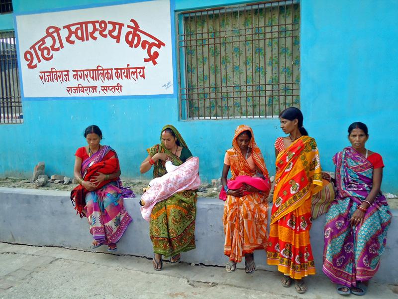 Women waiting outside Urban Health Service Centre to immunise their children, in nRajbiraj, Saptari, on Friday.