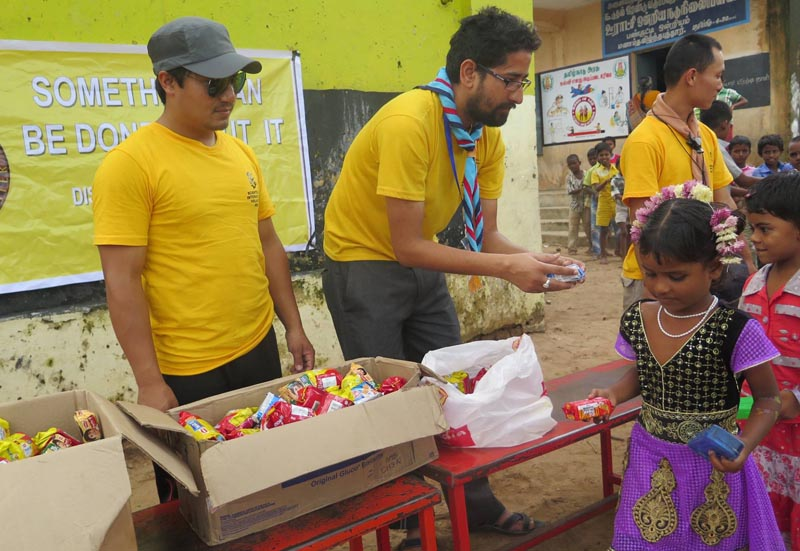 Volunteer Ministers Nepal chapter members distributing relief goods to flood victims of Chennai, India in December 2015. Photo: Guna Raj Pyakurel
