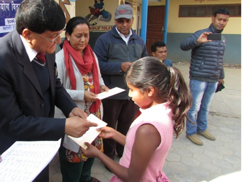 A child receives relief support from the Lalitpur District Child Welfare Board and the Children and Women in Social Service and Human Rights (CWISH), in Lalitpur. Photo: CWISH