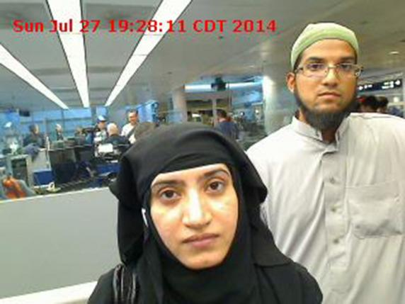 Tashfeen Malik, (L), and Syed Farook are pictured passing through Chicago's O'Hare International Airport in this July 27, 2014 handout photo obtained by Reuters December 8, 2015. Photo: Reuters