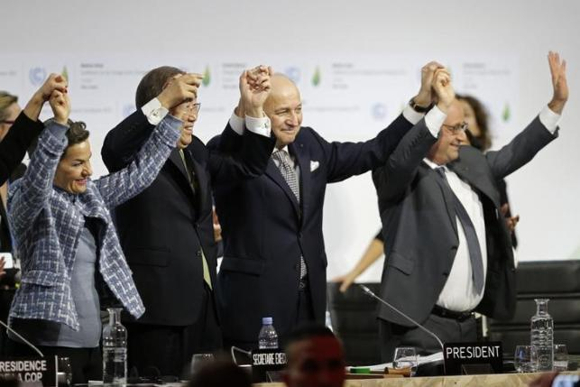 From L-R, Christiana Figueres, Executive Secretary of the UN Framework Convention on Climate Change, United Nations Secretary-General Ban Ki-moon, French Foreign Affairs Minister Laurent Fabius, President-designate of COP21 and French President Francois Hollande react during the final plenary session at the World Climate Change Conference 2015 (COP21) at Le Bourget, near Paris, France, December 12, 2015. Photo: Reuters