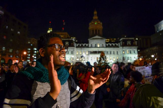 Protesters march at city hall in Baltimore, December 16, 2015. Photo:    REUTERS
