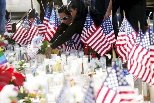 People leave flowers at a makeshift memorial after last week's shooting in San Bernardino, California December 7, 2015.  Photo: REUTERS