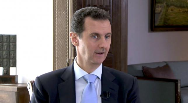 Syrian President Bashar al-Assad speaks during a TV interview in Damascus, Syria in this still image taken from a video on November 29, 2015.  Photo: REUTERS