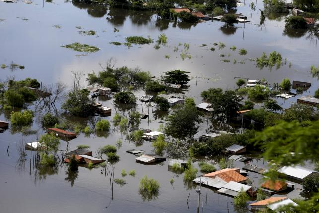 Houses are partially submerged in floodwaters in Asuncion, in this December 20, 2015 file photo.  Photo: Reuters