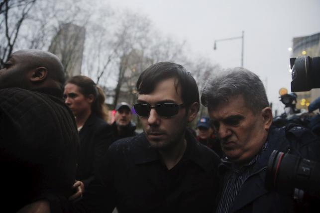 Martin Shkreli departs the US Federal Court after an arraignment following him being charged in a federal indictment filed in Brooklyn, December 17, 2015. Photo: REUTERS